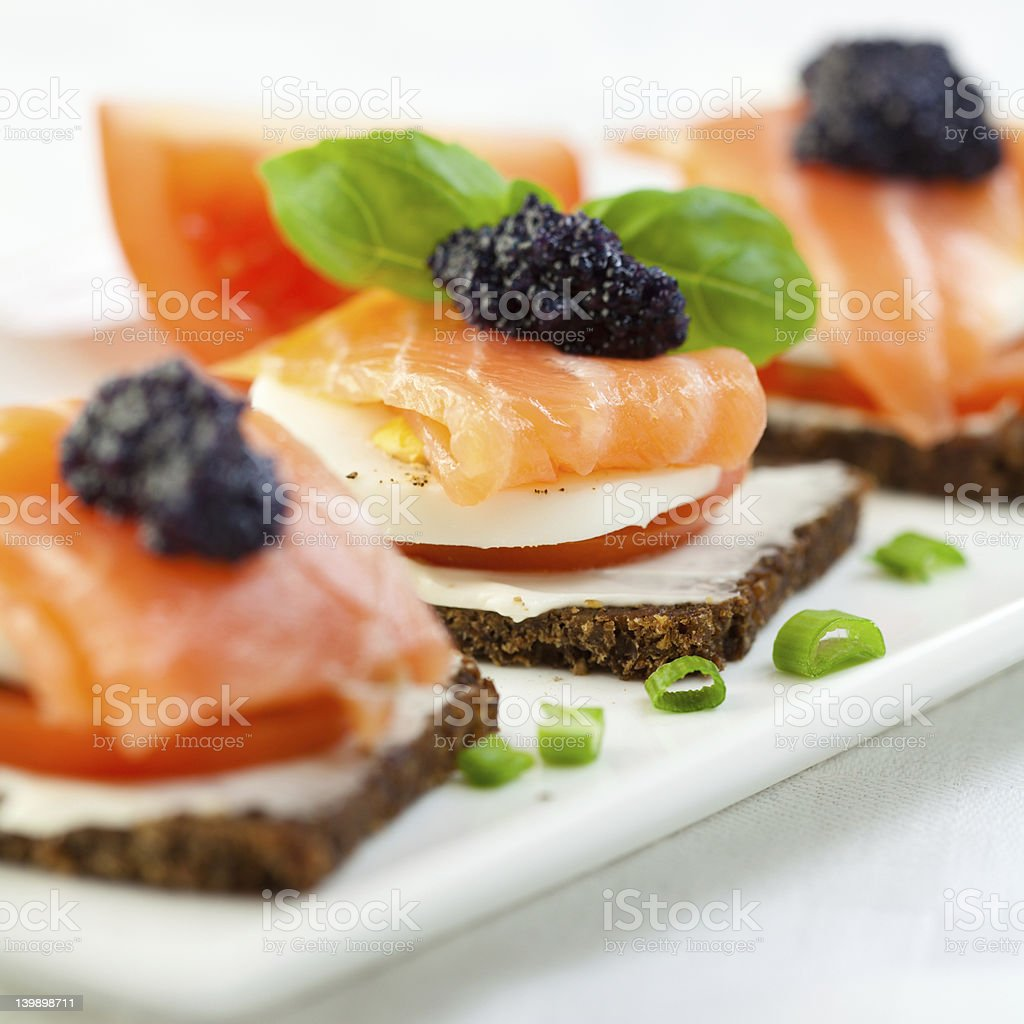 Delicious canapes with salmon and caviar stock photo