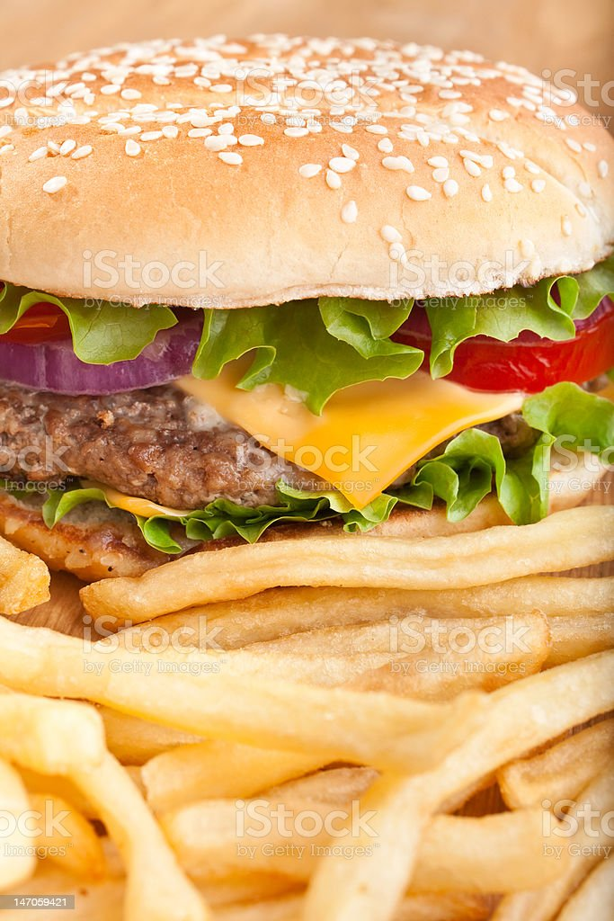 delicious cheeseburger with french fries royalty-free stock photo