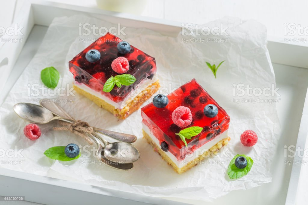 Delicious cheesecake made of jelly and berries stock photo