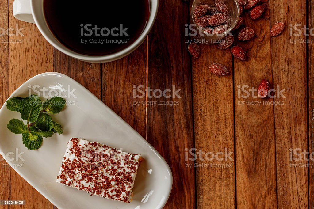Delicious cheesecake with mint on a wooden table stock photo