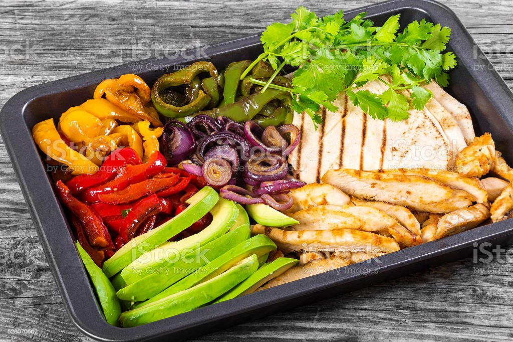 Delicious Chicken Fajita Platter with Avocado, close-up stock photo