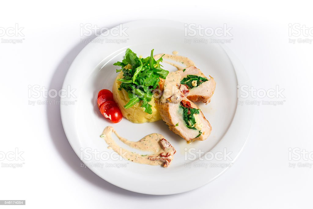 Delicious chicken rolls stuffed with spinach stock photo