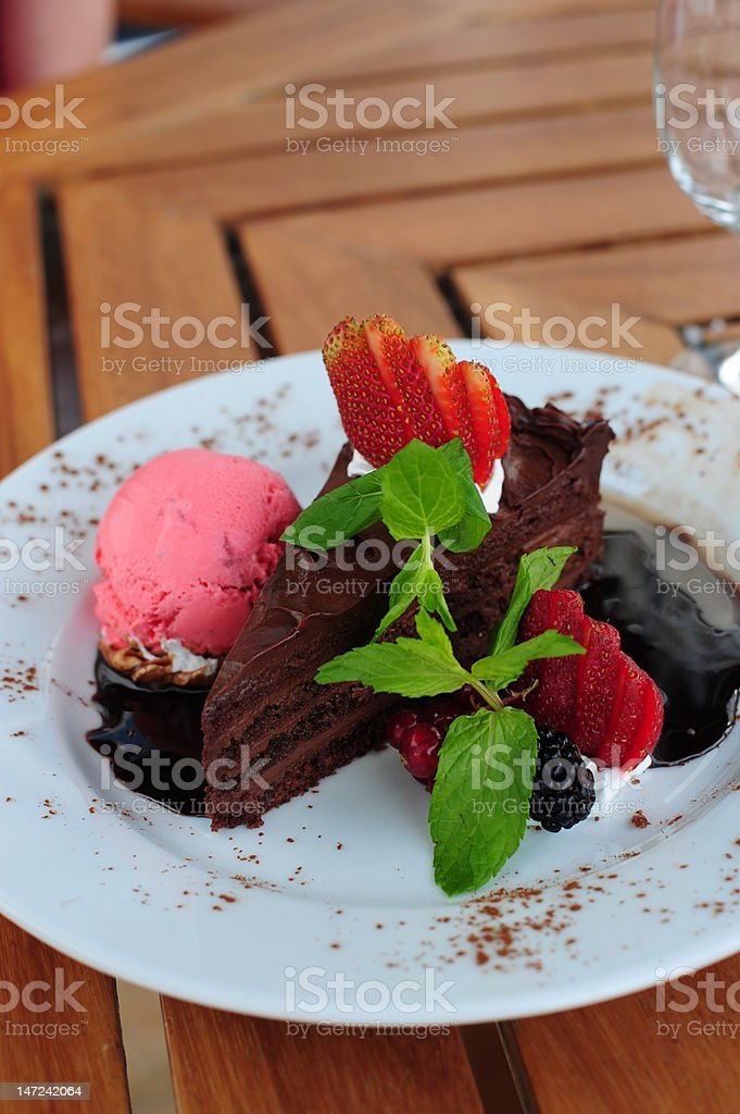 Delicious chocolate cake with garnish royalty-free stock photo