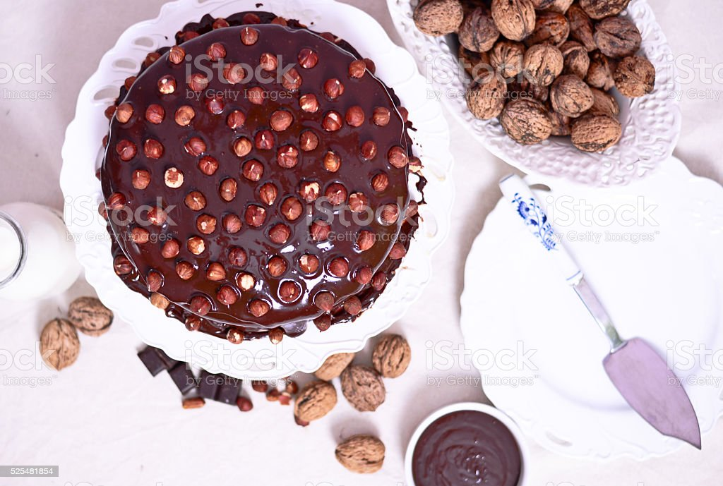Delicious chocolate cakes with hazelnut on table close-up stock photo