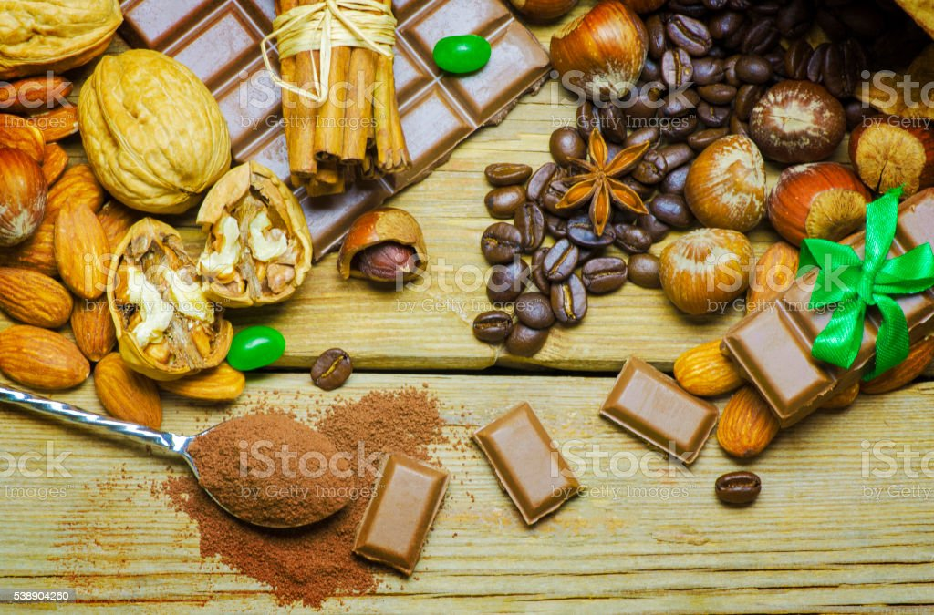 Delicious chocolates with roasted coffee beans and nuts stock photo