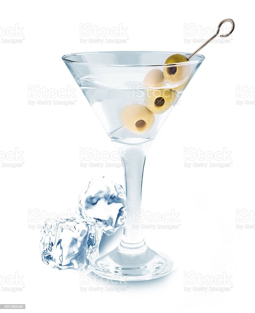 Delicious cocktail with olives and ice cubes in martini glass. stock photo