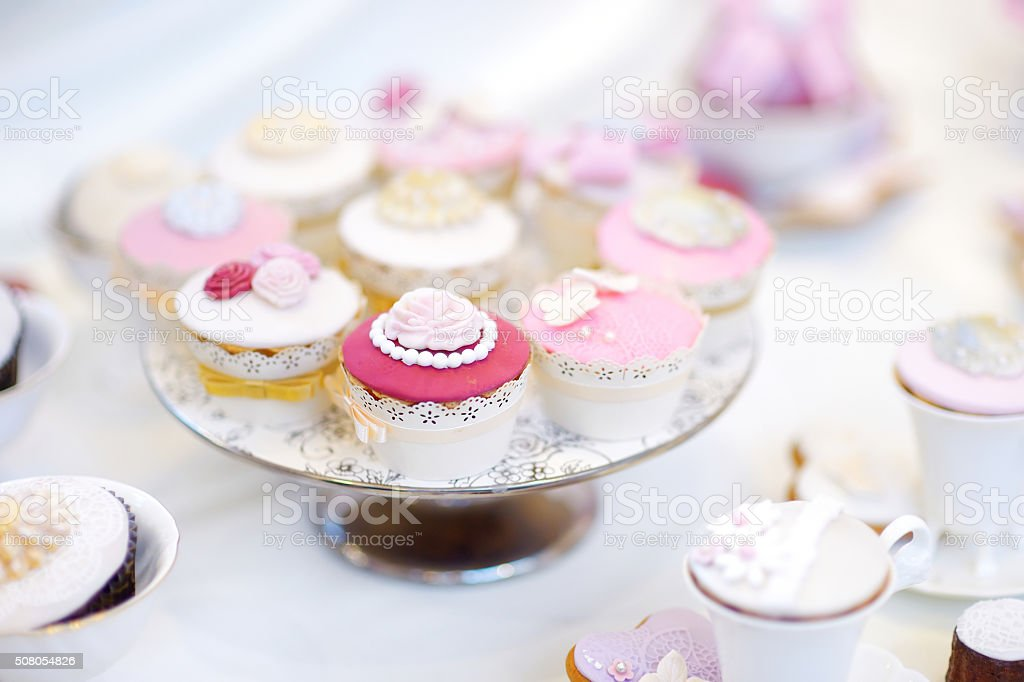 Delicious colorful wedding cupcakes stock photo