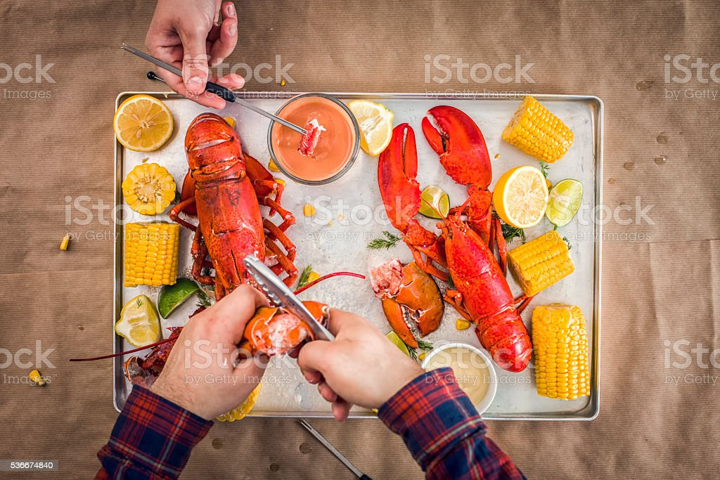 Delicious Cooked Lobster with Sweetcorn, lemon and Dipping Sauce stock photo