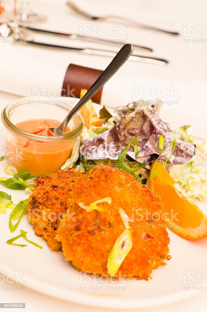 Delicious crab cakes with spicy cocktail sauce stock photo