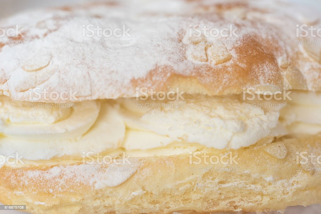 Delicious cream pastry macro picture, central selective focus. stock photo