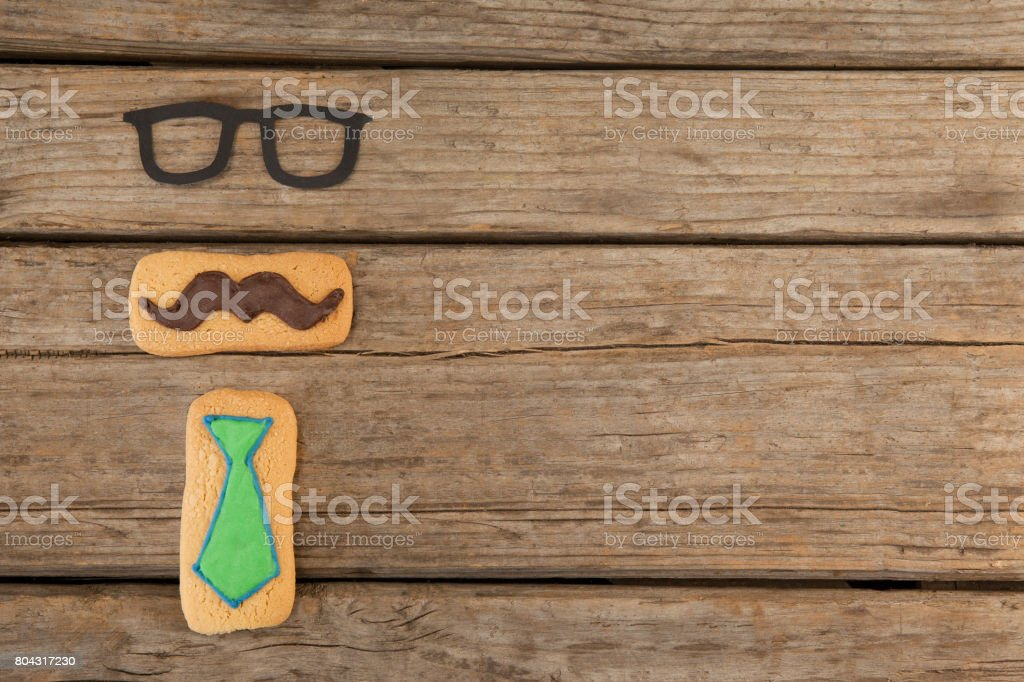 Delicious creative cookies and spectacles on wooden plank stock photo