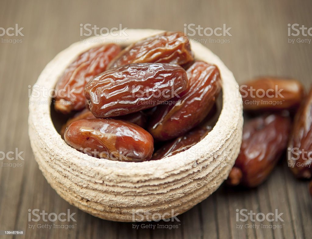 Delicious dates in small bowl stock photo