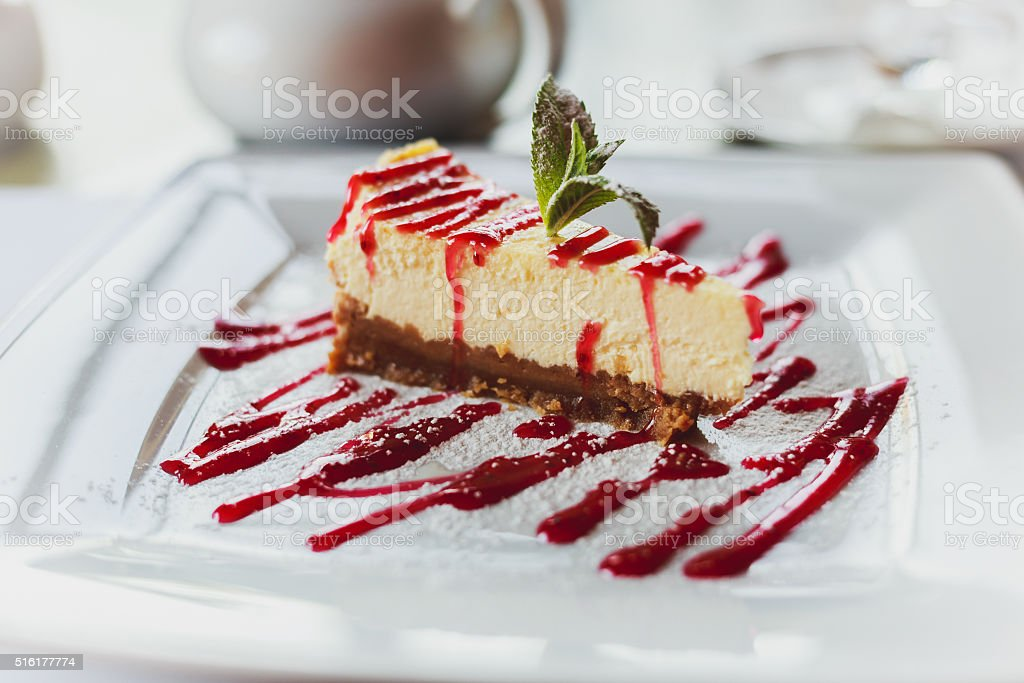 Delicious dessert cheesecake with cherry jam stock photo
