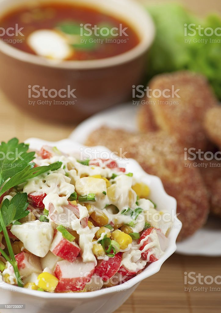 delicious dinner closeup bowl(crab salad,burgers,borscht) royalty-free stock photo