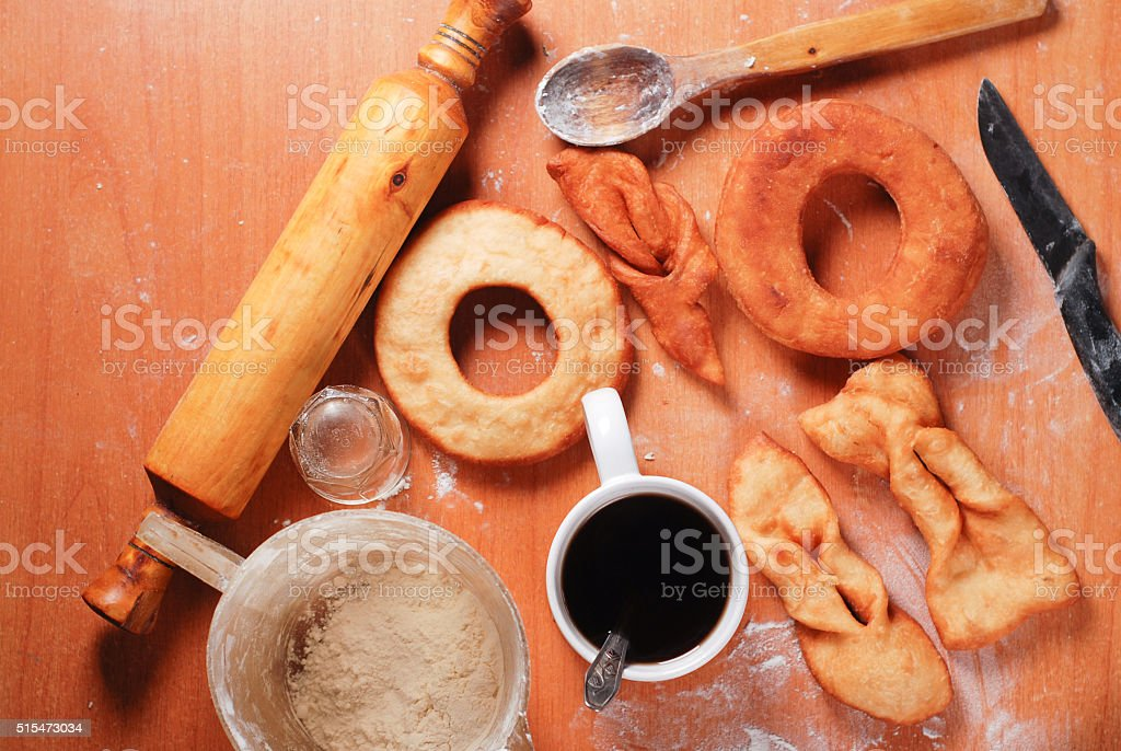 Delicious donuts and a black coffee on the table. stock photo