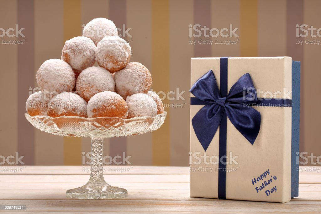 Delicious donuts and gift box stock photo