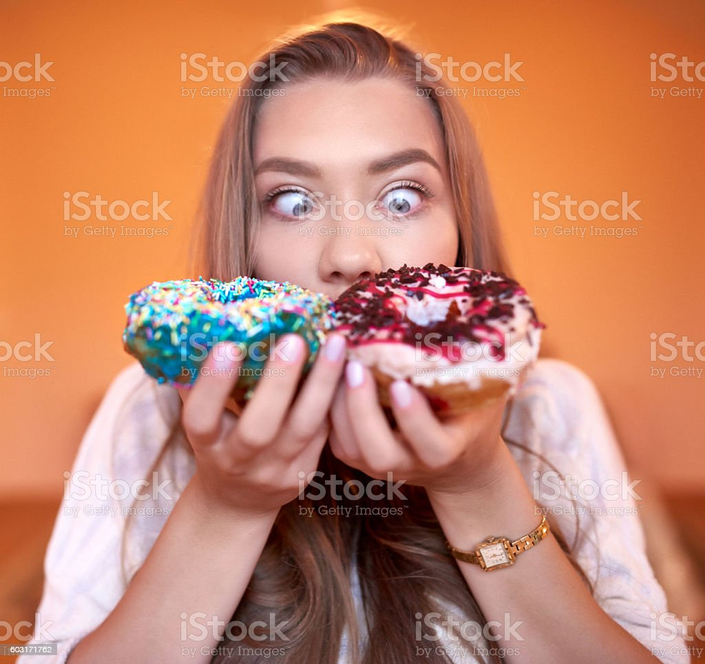 delicious donuts in my hands stock photo