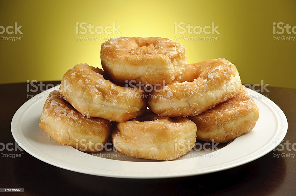 Delicious Donuts on Plate with Yellow Background royalty-free stock photo