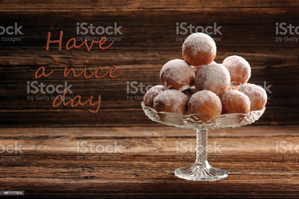 Delicious donuts on wooden background stock photo