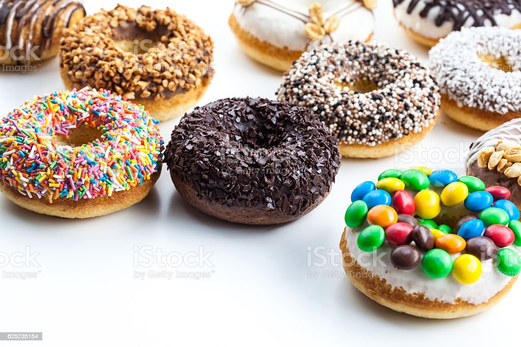 Delicious donuts with icing isolated on white stock photo