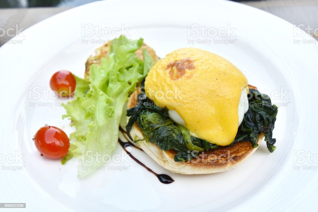 Delicious Eggs Benedict with Spinach stock photo