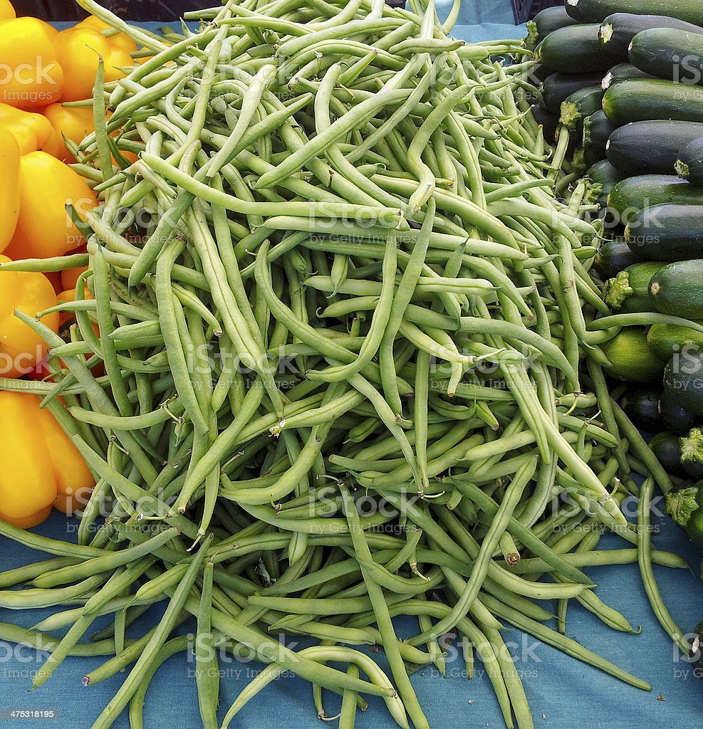 Delicious farm fresh green beans on a farmers market. stock photo