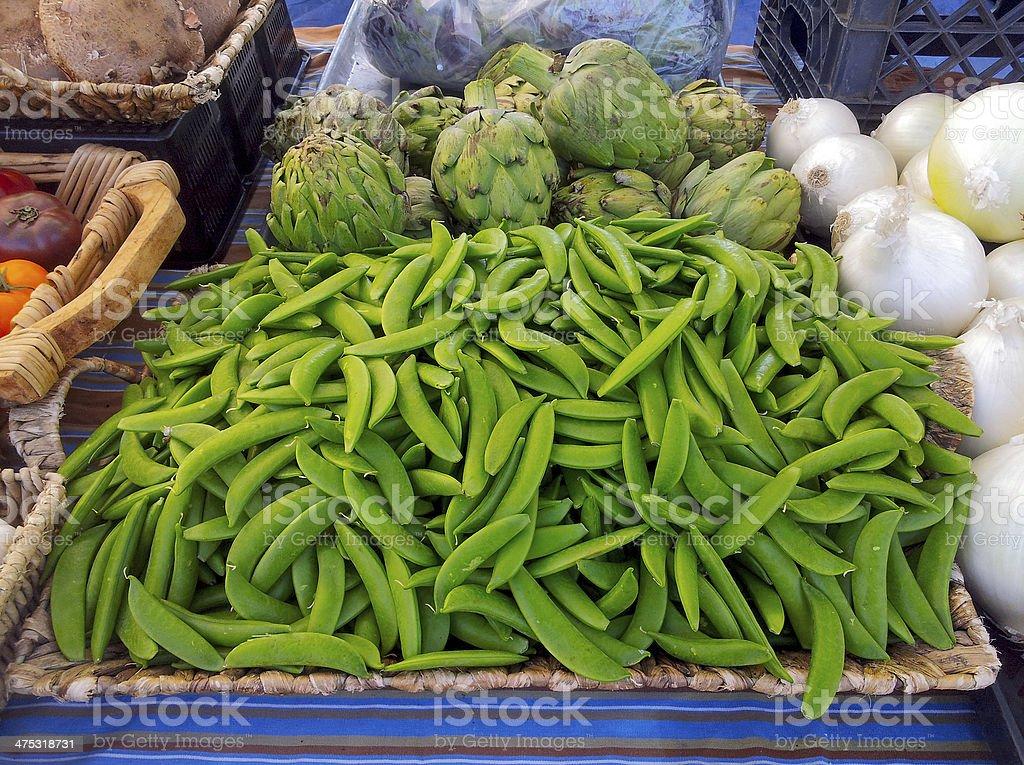Delicious farm fresh green pod peas,onion and artichoke royalty-free stock photo