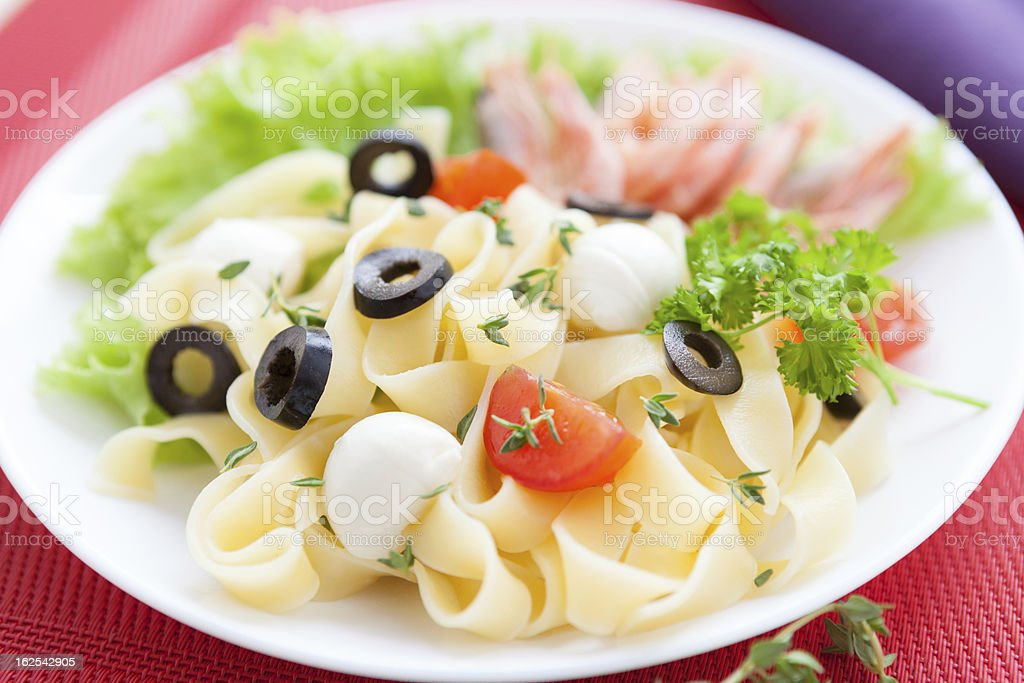 delicious fettuccine and mozzarella on a plate royalty-free stock photo