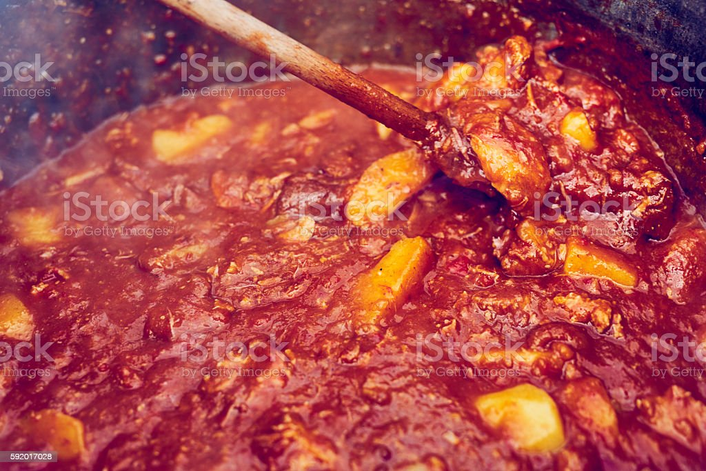 delicious food inside cauldron stock photo