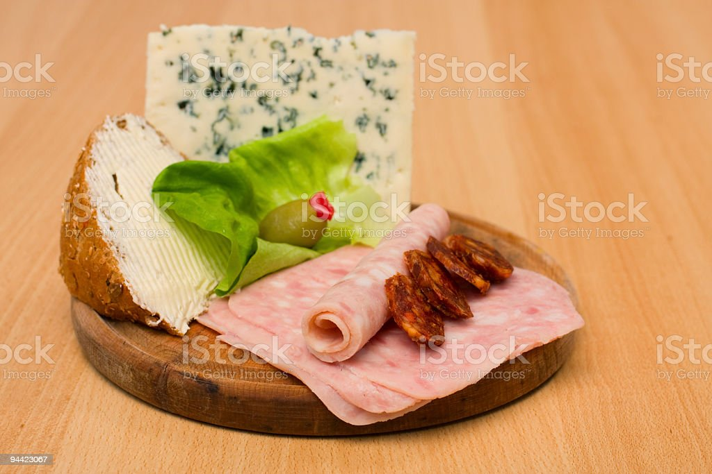 Delicious food on wooden plate royalty-free stock photo