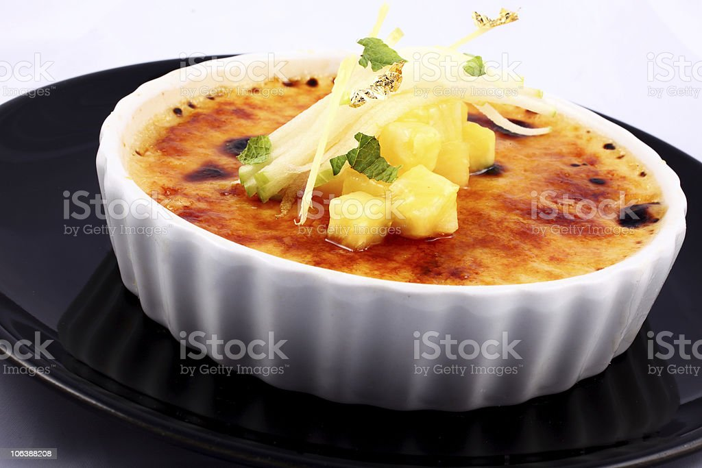 Delicious french dessert creme brulee in porcelain bowl royalty-free stock photo