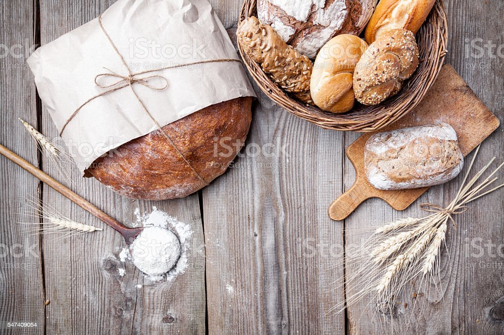 Delicious fresh bread on wooden background stock photo