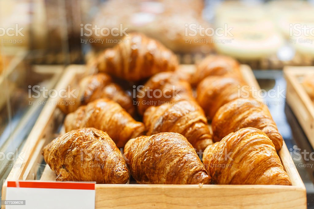 Delicious fresh croissants in the shop stock photo