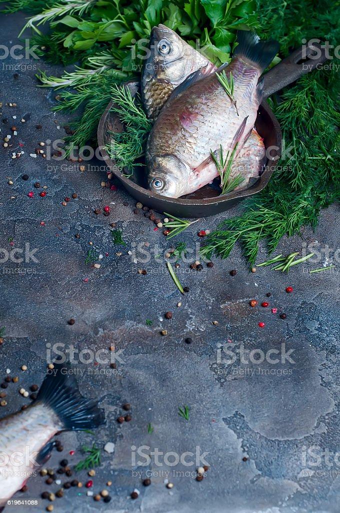 Delicious fresh fish on dark vintage background. stock photo