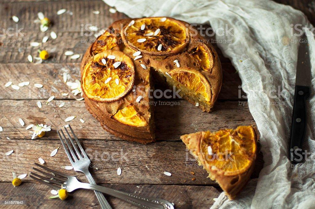 Delicious fresh homemade pie with orange zest, milk, butter, egg stock photo