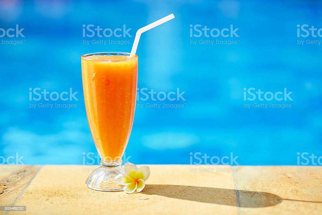 Delicious fresh mango juice near the pool stock photo