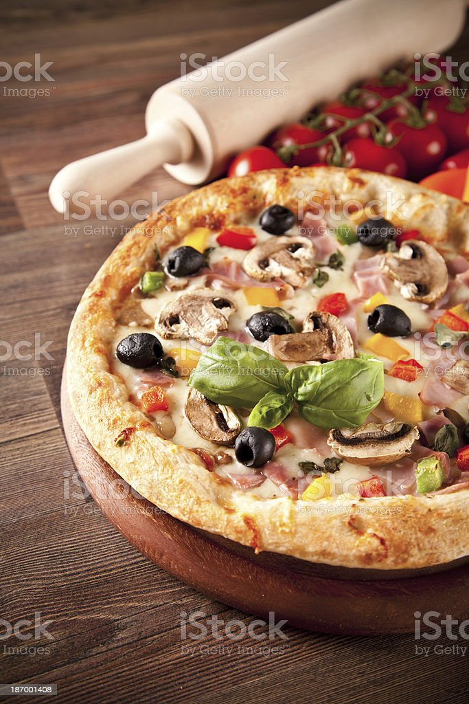 Delicious fresh pizza served on wooden table royalty-free stock photo