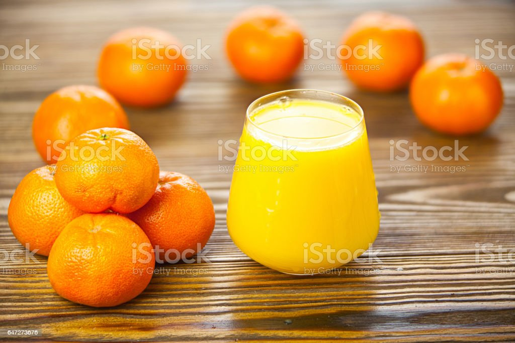 Delicious fresh squeezed tangerine juice in  transparent glass stock photo