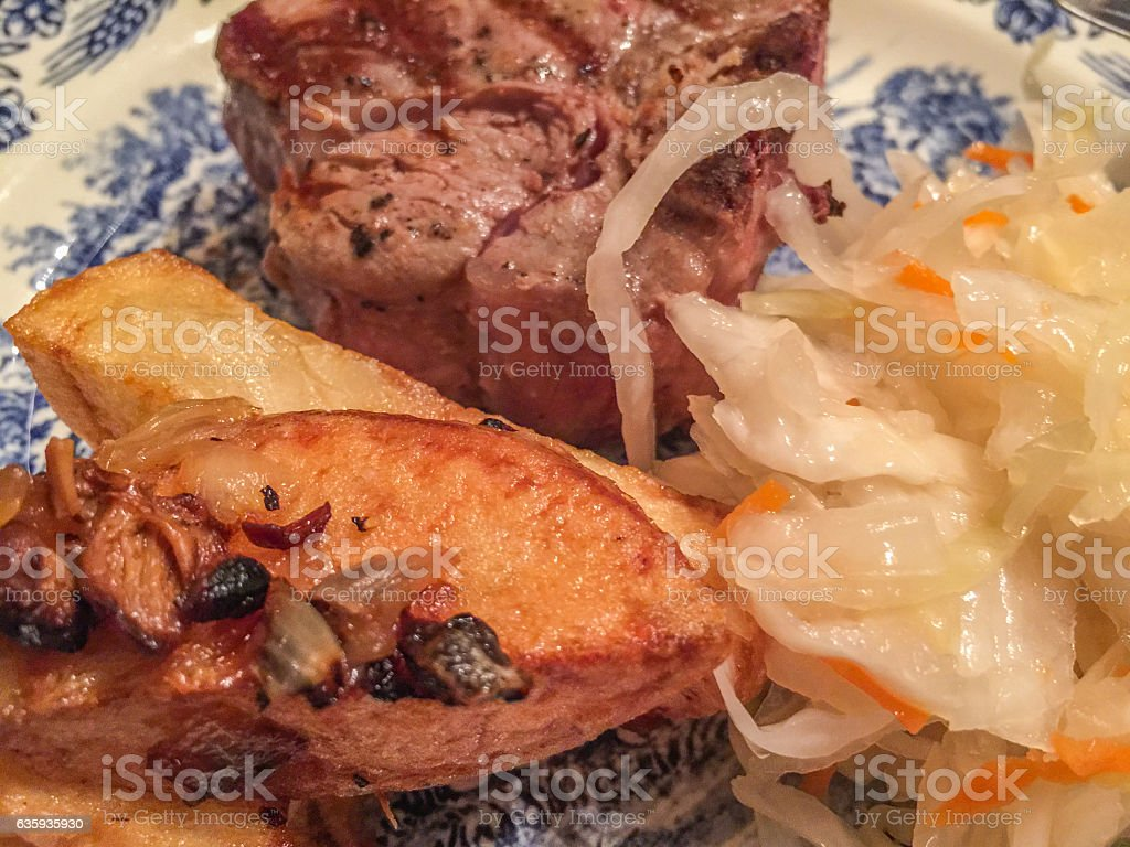 Delicious fried potato, meat and salad stock photo