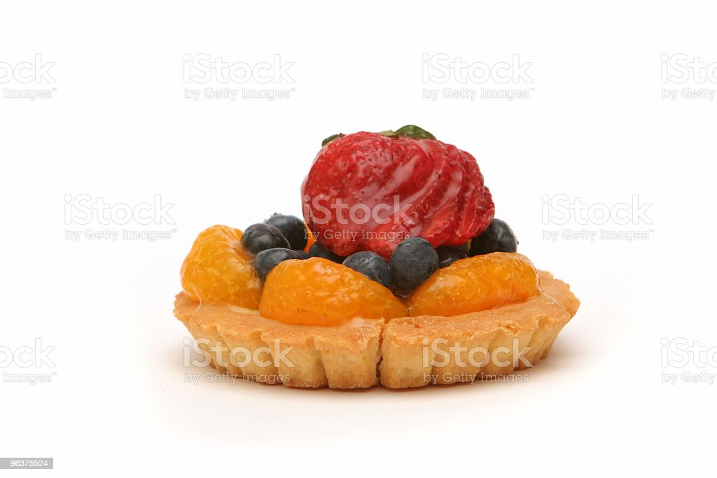 Delicious fruit tart decorated with berries royalty-free stock photo