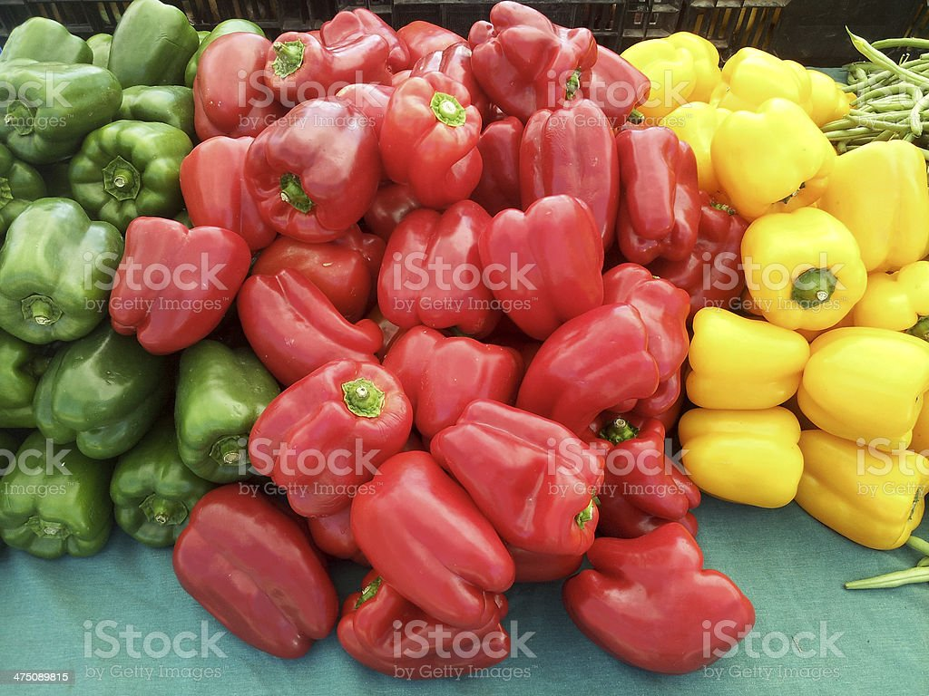 Delicious green, red, yellow bell peppers at farmers market. stock photo