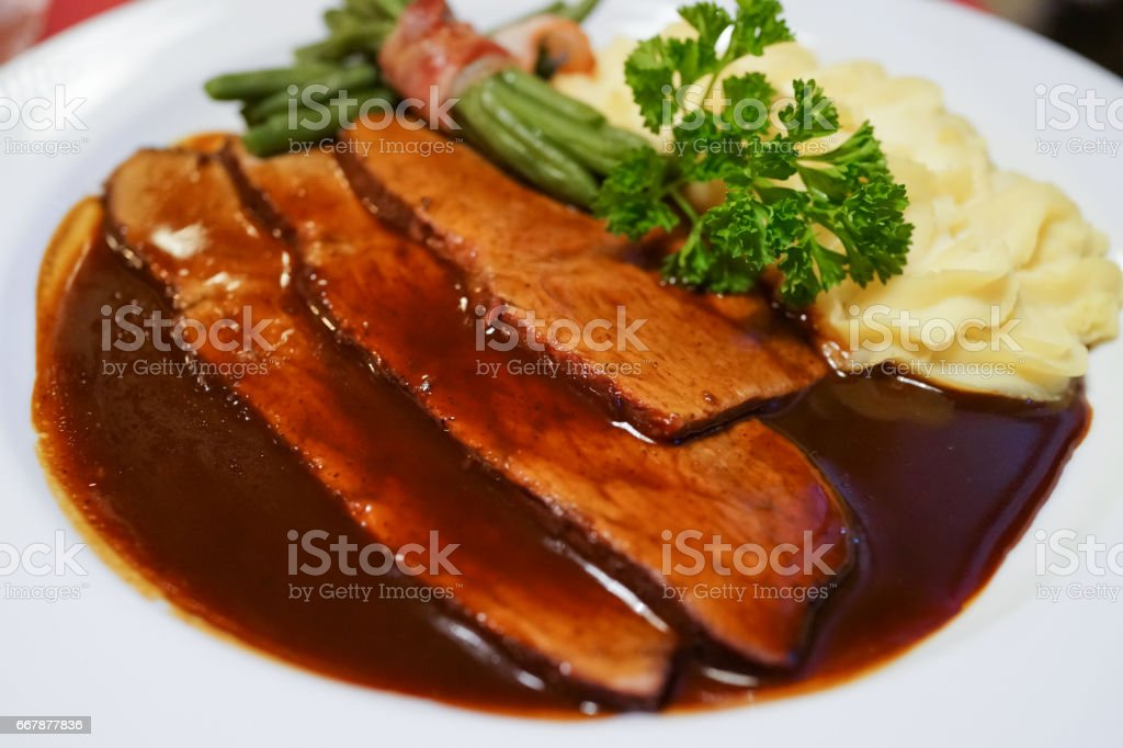 Delicious grilled beef tenderloin with red wine sauce stock photo