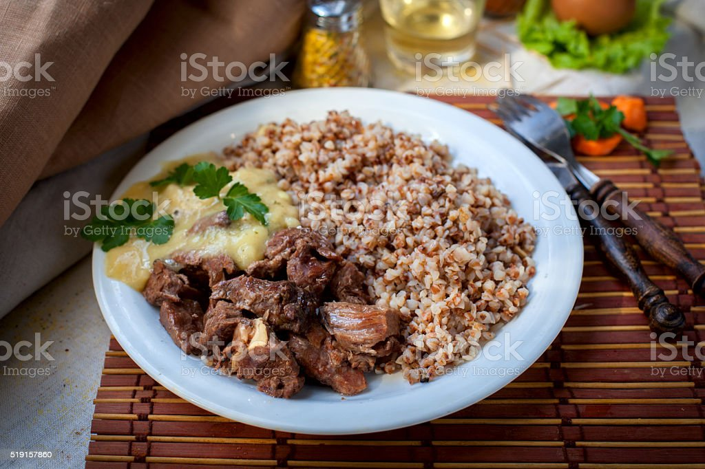 delicious grilled meat with vegetable and buckwheat stock photo
