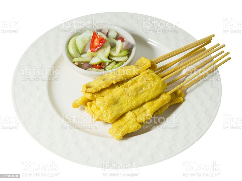 Delicious Grilled Pork Satay with Cucumber Salad stock photo