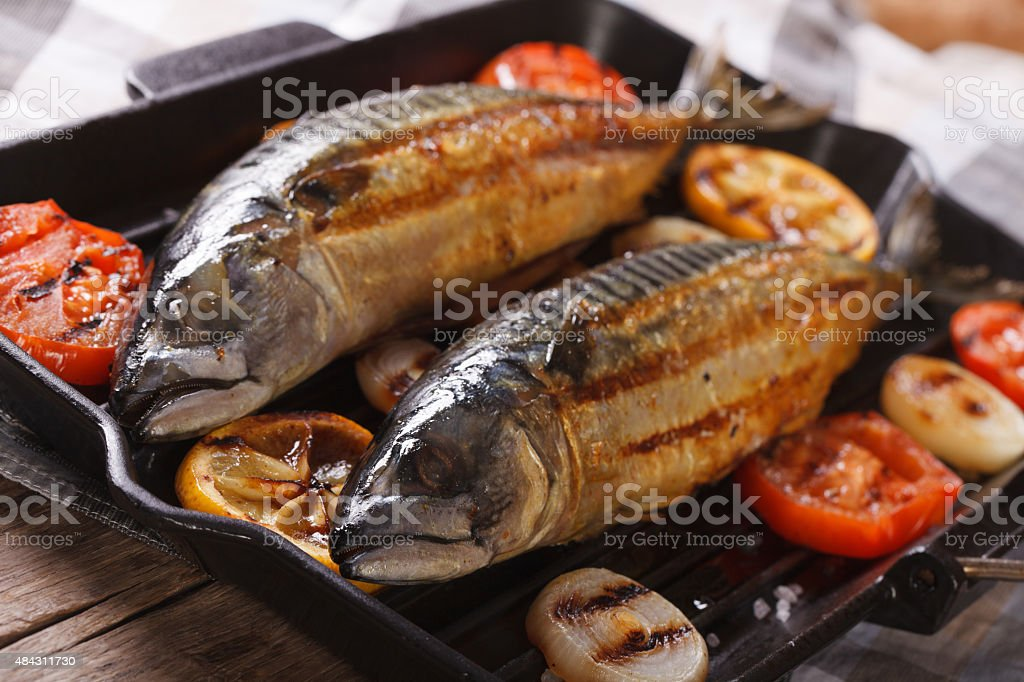 delicious grilled sea fish and vegetables in a pan grill stock photo
