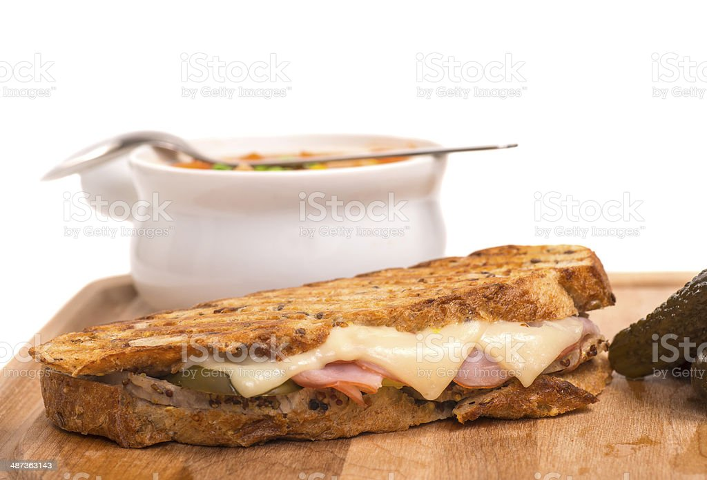 Delicious ham, pork and swiss cheese panini with vegetable soup stock photo