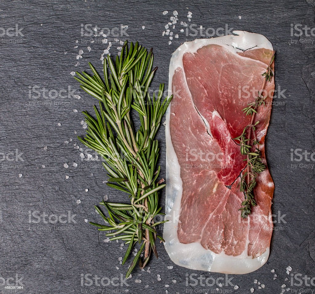 Delicious ham slices with rosemary and salt stock photo