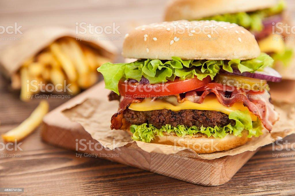 Delicious hamburger and fries stock photo