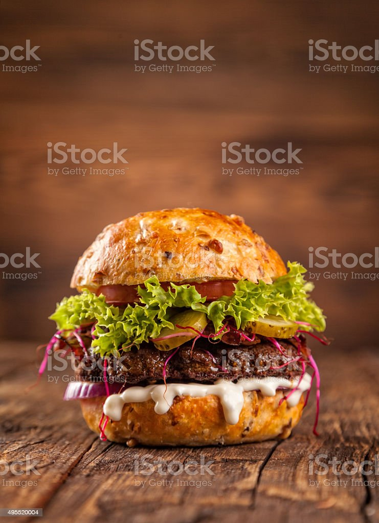 Delicious hamburger on wood stock photo