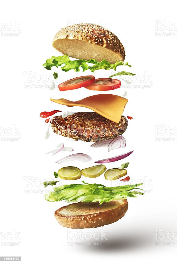 Delicious hamburger with flying ingredients stock photo